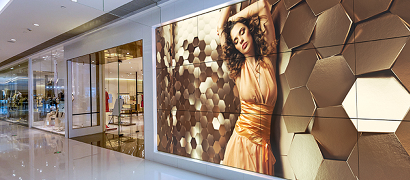 retail videowall gold signage