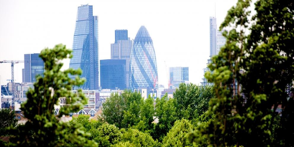 london skyline with trees foreground